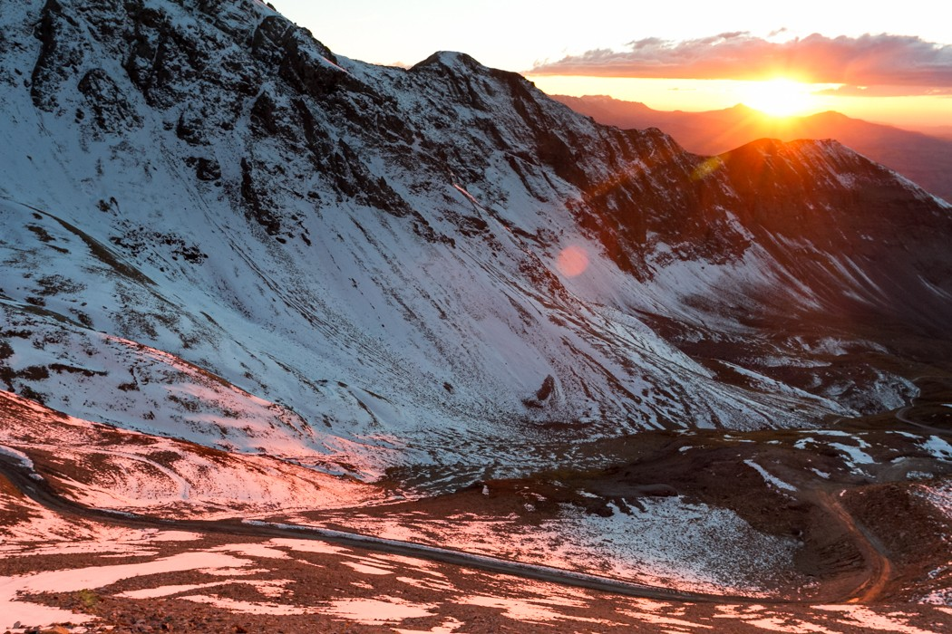 The sun falls behind the mountains to the west of Imogene Pass.