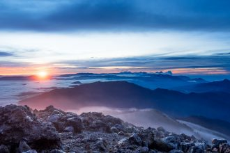 Sunrise reveals a horizon full of volcanoes. Summit of Volcán Tajumulco, Guatemala - GreatDistances / Matt Wicks