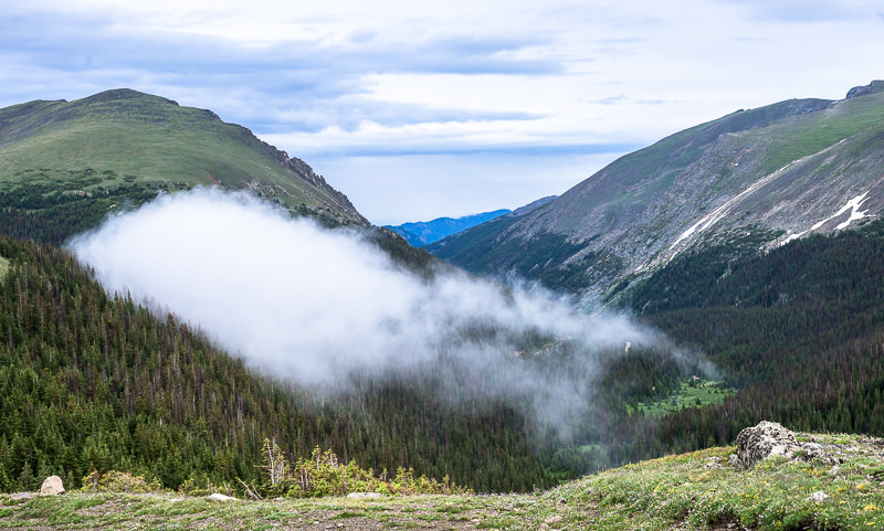 strange ground fog fades into a hillside near the top of Old Fall River Road. Rocky Mountain National Park. GreatDistances / Matt Wicks