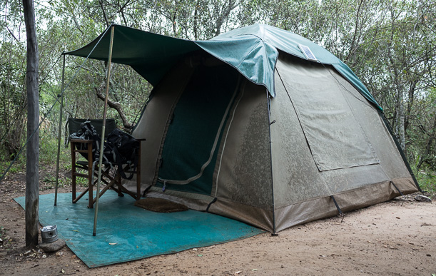 my tent at Mara Explorers on a damp day. The pole to the left is mounted with lights set off by motion detectors just in case wildlife manages to get past the camp's fence. I could hear hyenas in the distance at night! GreatDistances / Matt Wicks