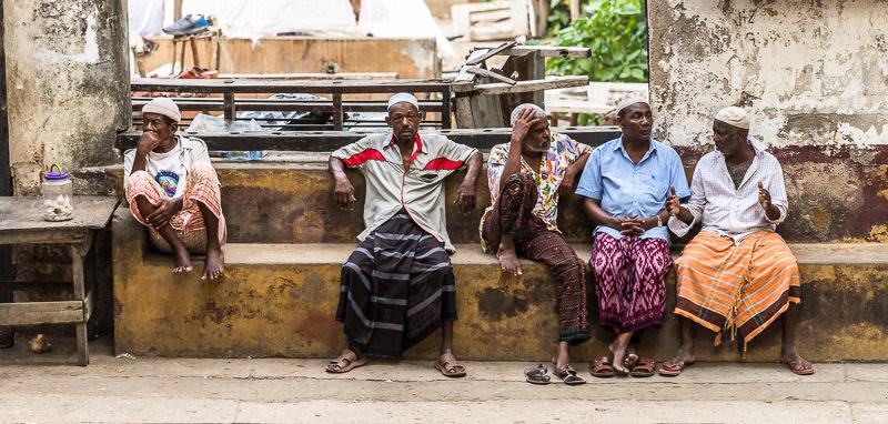 Men in Lamu's central square. GreatDistances / Matt Wicks