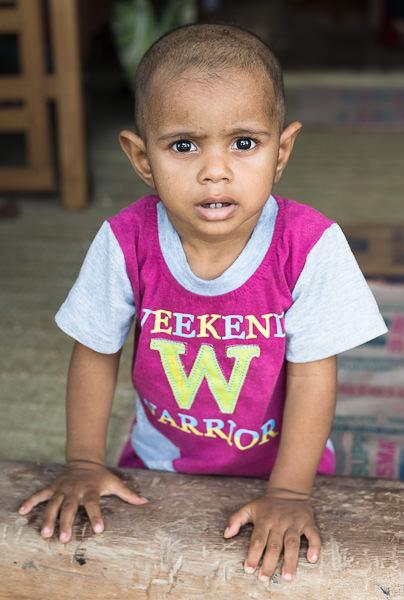 "young child wears a ""Weekend Warrior"" shirt in Lamu, Kenya. GreatDistances / Matt Wicks"