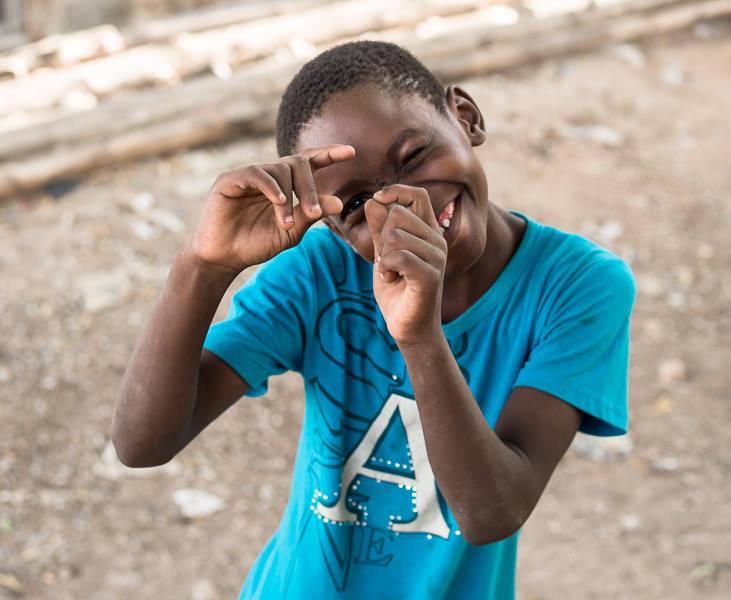 boy shoots a picture on an imaginary camera in Lamu, Kenya. GreatDistances / Matt Wicks