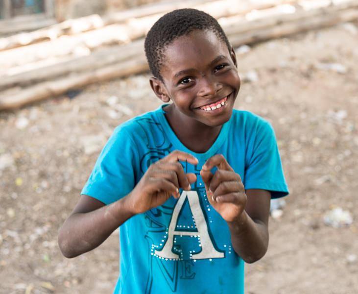 Boy smiles in Lamu Kenya. GreatDistances / Matt Wicks