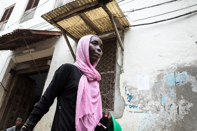 young girl in pink headscarf in Lamu, Kenya. GreatDistances / Matt Wicks