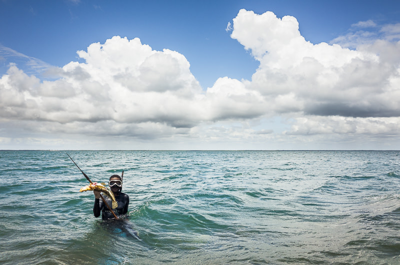 Spear fisherman with fresh catch in Lamu, Kenya. GreatDistances / Matt Wicks
