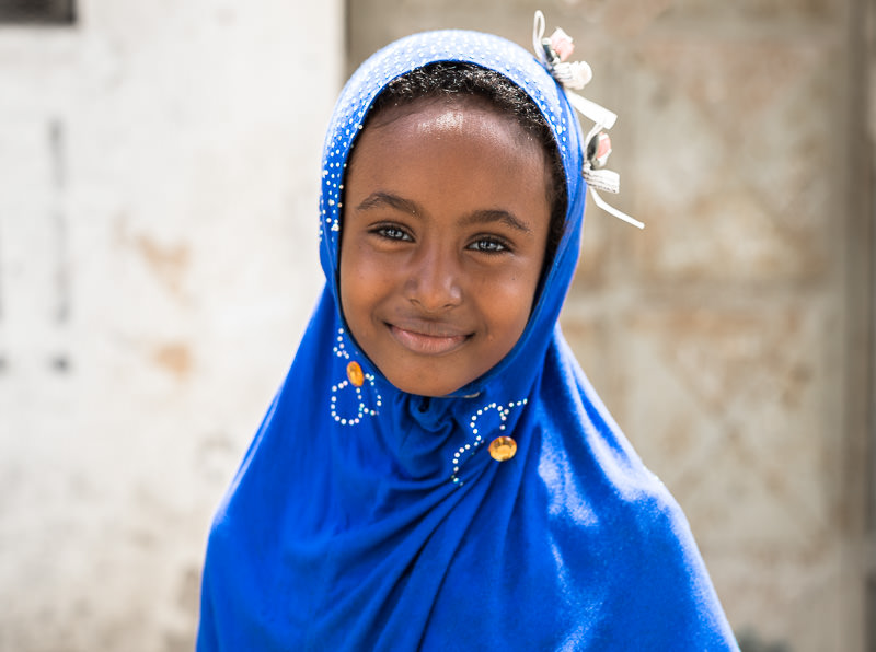 Beautiful young girl in blue. Old Town Mombasa, Kenya. One Month in Kenya - GreatDistances / Matt Wicks