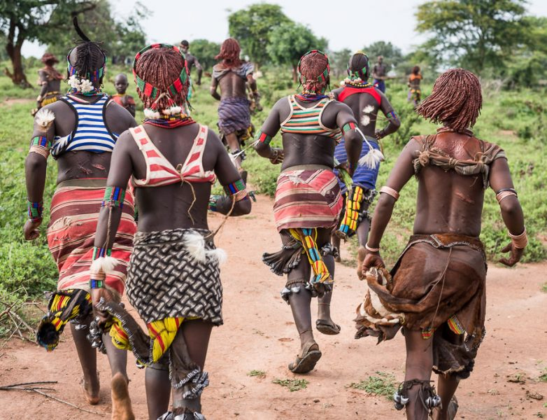 Hamar women running after whippers or maza at a Hamar Bull Jumping Ceremony. South Omo Part 2 - GreatDistances / Matt Wicks