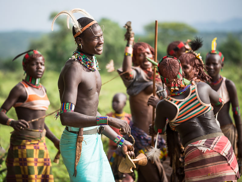 Men and women of Hamar tribe, during the beginning of a bull jumping (coming of age) ceremony. Dimeka, South Omo, Ethiopia. How To Visit South Omo, Ethiopia (Omo Valley) - GreatDistances / Matt Wicks