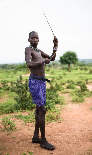 Hamer man flexes his whip. Photographing the Tribes of South Omo, Ethiopia - GreatDistances / Matt Wicks