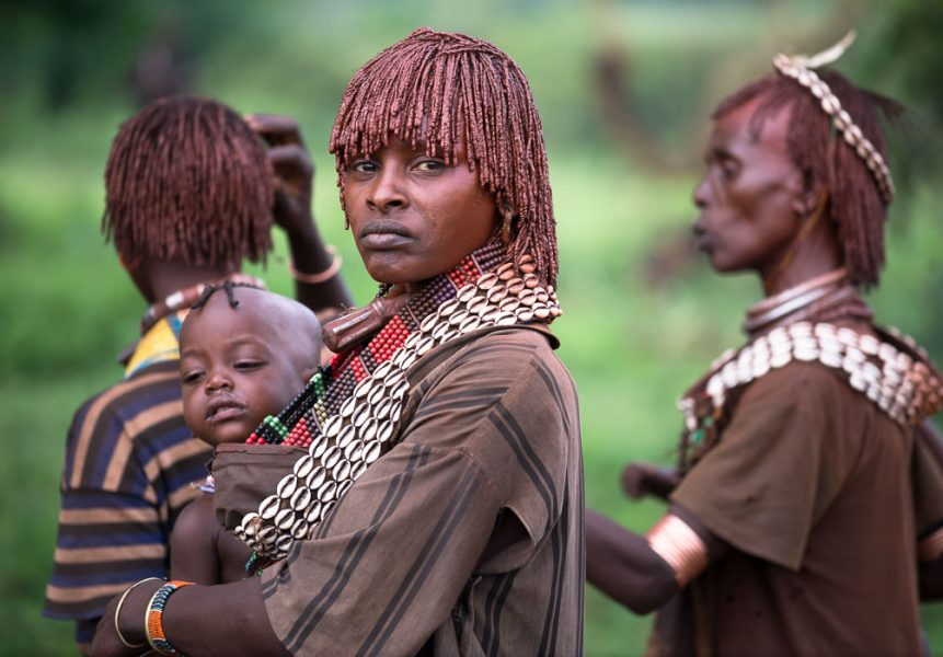 Hamar woman in traditional clothing at a Hamar Bull Jumping Ceremony - South Omo Part 2 - GreatDistances / Matt Wicks