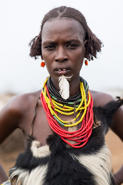 Dassenech tribe woman with labret piercing. Omorate, South Omo, Ethiopia. How To Visit South Omo, Ethiopia (Omo Valley) - GreatDistances / Matt Wicks