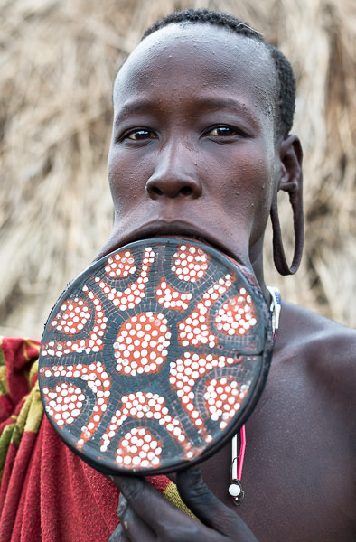 Mursi tribe woman with large clay lip plate. Mago National Park, South Omo, Ethiopia. How To Visit South Omo, Ethiopia (Omo Valley) - GreatDistances / Matt Wicks