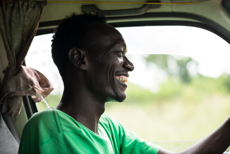 Man driving minibus and smiling - How To Visit South Omo, Ethiopia (Omo Valley) - GreatDistances / Matt Wicks