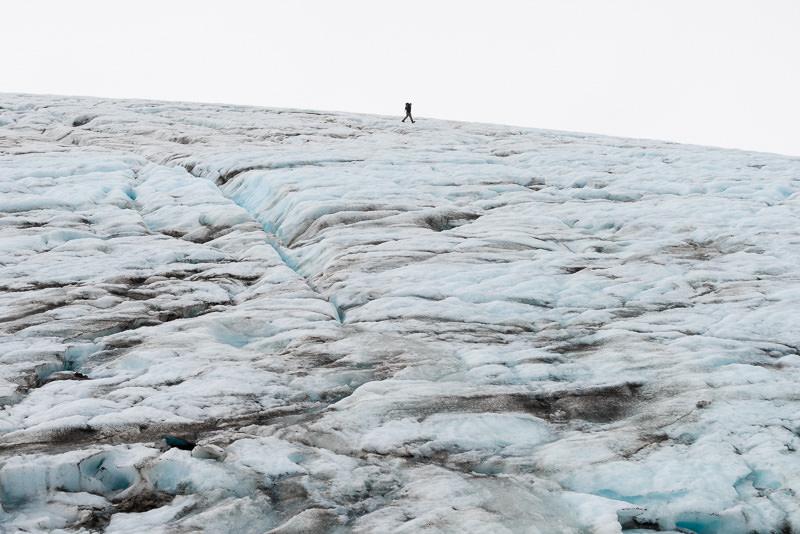A hiker wearing crampons walks on the Harding Icefield. Kenai Fjords National Park, near Seward, Alaska. GreatDistances / Matt Wicks - Two Weeks in Alaska: Selected Photos