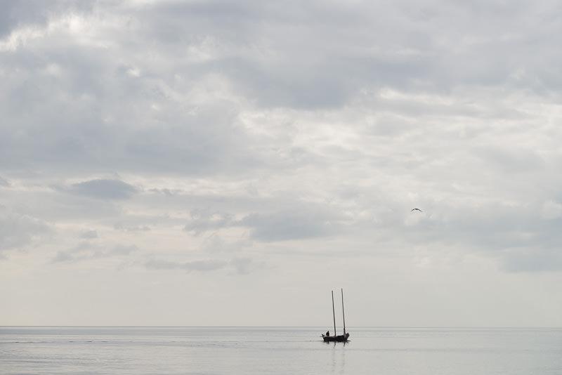A lone boat in Katchemak Bay in the afternoon. Homer, Alaska. GreatDistances / Matt Wicks - Two Weeks in Alaska: Selected Photos