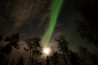 Green Aurora Borealis activity and moon, viewed from Fairbanks, Alaska. GreatDistances / Matt Wicks - Two Weeks In Alaska