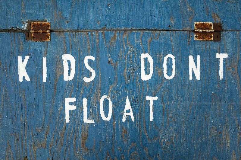 """""""KIDS DON'T FLOAT"""" signage on a crate full of public use life vests in the marina of Whittier, Alaska. GreatDistances / Matt Wicks - Two Weeks in Alaska: Selected Photos"""