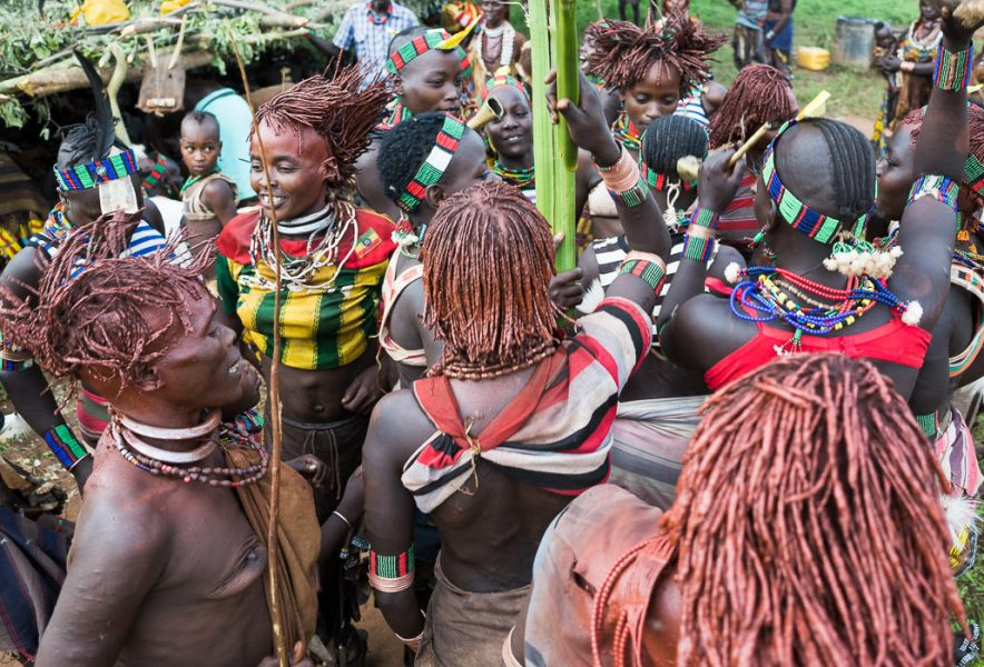 Hamar women dancing and singing at a Hamar Bull Jumping Ceremony. South Omo Part 2 - GreatDistances / Matt Wicks